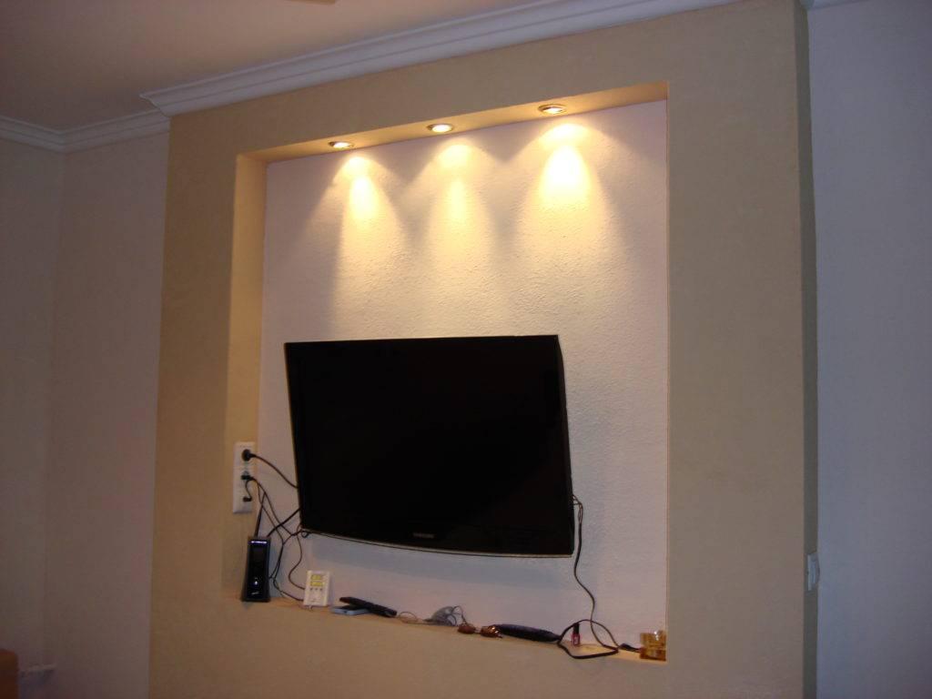 Что собой представляет ниша из гипсокартона под телевизор в интерьере: 35 фото