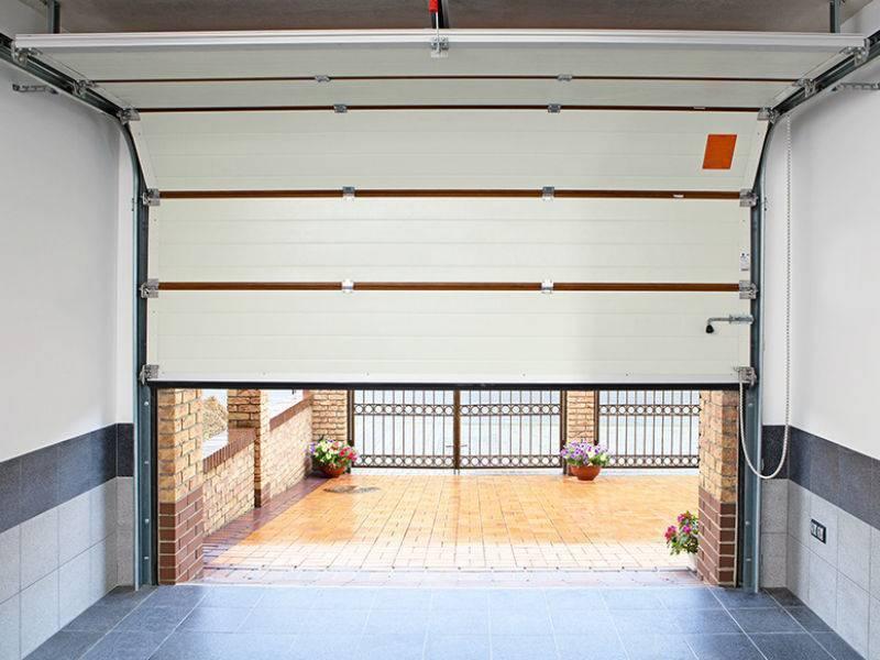 Как утеплить ворота гаража пеноплексом и минватой полезные советы
