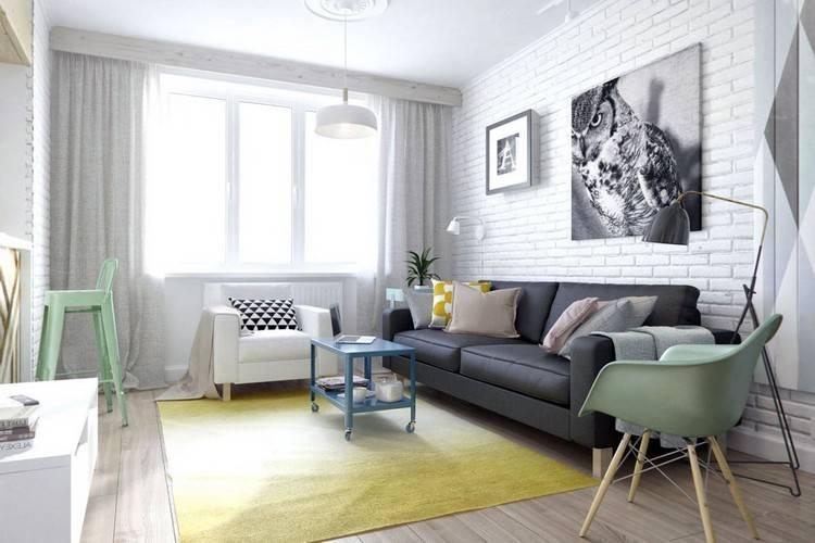 Как украсить стену над диваном в гостиной — варианты оформления