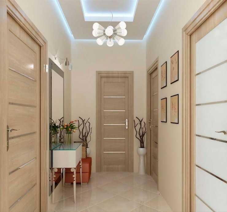 Освещение в длинном или небольшом коридоре: бра над зеркалом или освещение в прихожей над входной дверью, подвесные люстры или освещение зеркала?