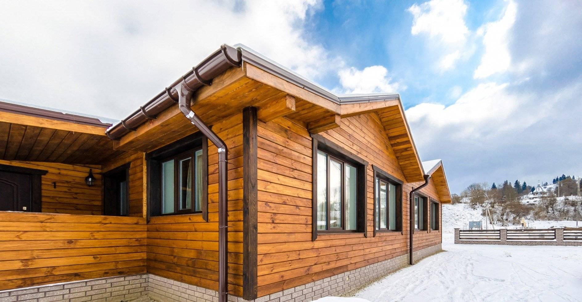 Внешняя обшивка каркасного дома: фасадная плитка, натуральный и искусственный камень, декоративная штукатурка и сайдинг
