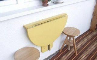 Откидной стол с креплением к стене: его особенности и механизм стенного крепежа