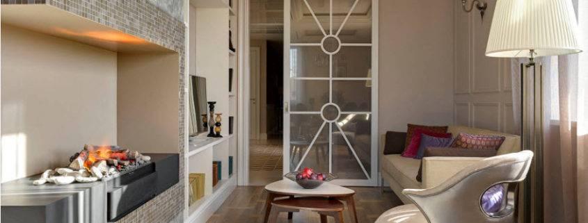 Современные электрокамины в интерьере гостиной: 50 фото