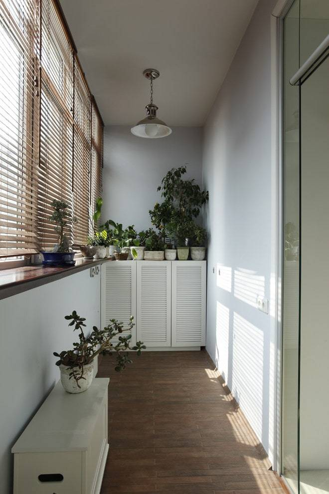 Советы по выбору рулонных штор на балкон