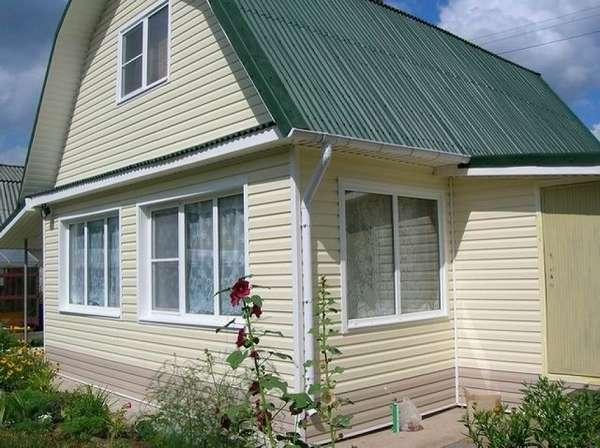 Облицовка фасада частного дома недорого: чем отделать лучше + советы - фото