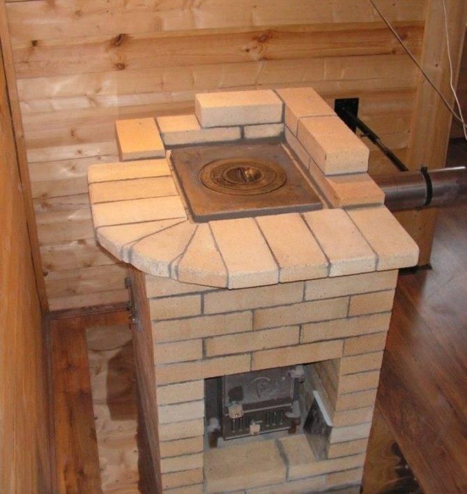 Отопительно-варочная печь с камином и сушилкой