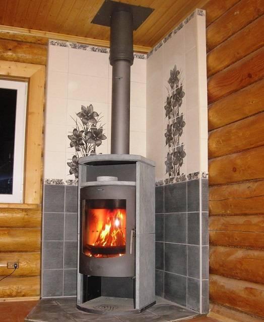 Печь или котел длительного горения - что выбрать для отопления загородного дома?