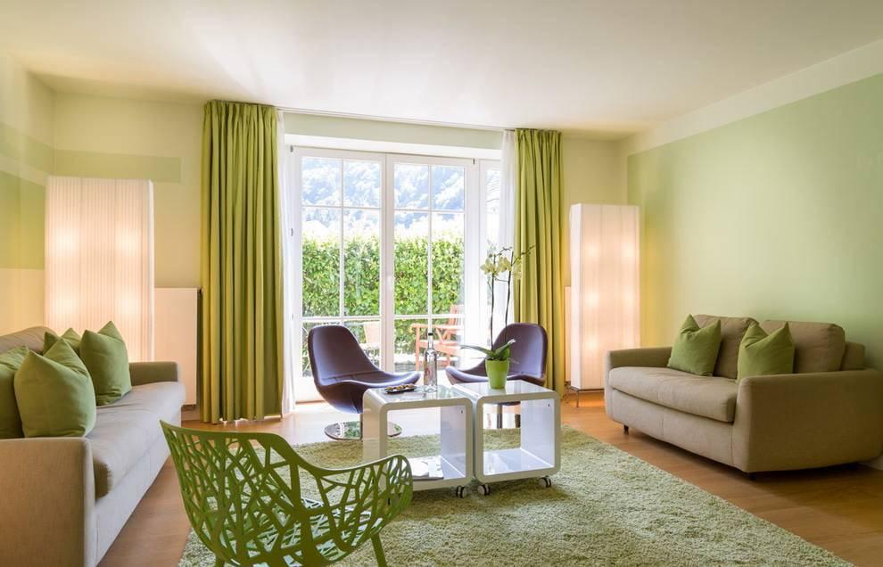 Угловые диваны в интерьере гостиной: преимущества, фото