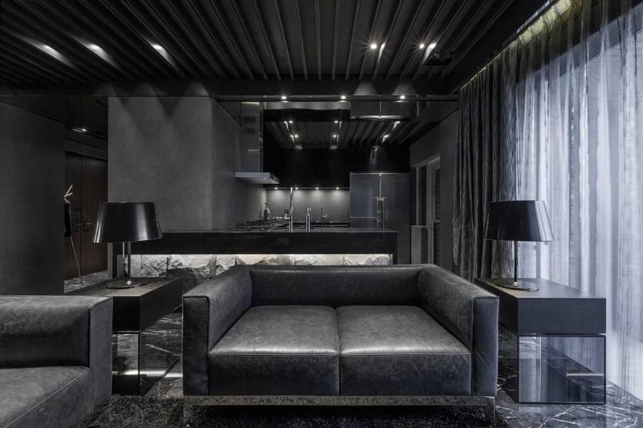 Стильная, комфортная гостиная в темных тонах