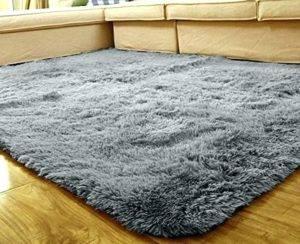 Белые ковры (53 фото): пушистые и мягкие овальные модели с длинным ворсом в интерьере гостиной