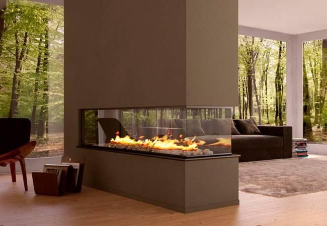 Стеклянные камины: как используется огнеупорное стекло в каминной тематике