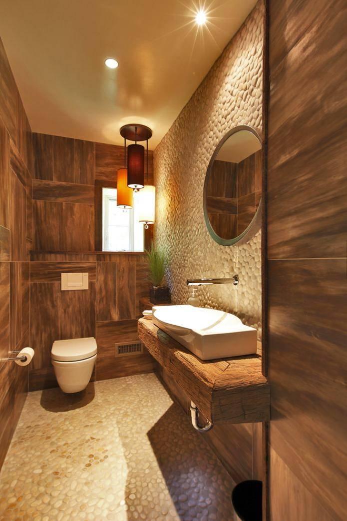 Освещение в туалете (33 фото): потолочный осветительный прибор небольшого размера, настенные светодиодные светильники для туалета и ванной