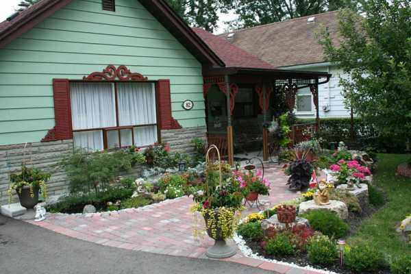 Как сделать благоустройство территории частного дома своими руками: принципы и основные элементы