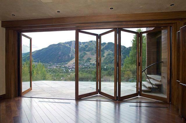 Как выбрать раздвижные окна для террасы, разновидности конструкций