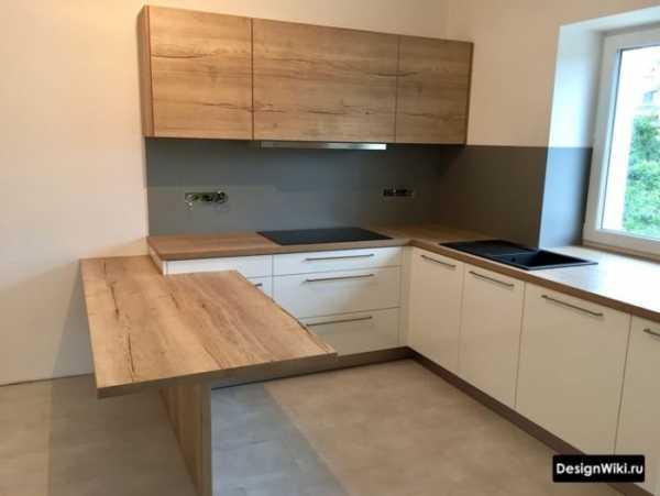 Белая кухня с черной столешницей и фартуком: какие темные и светлые оттенки рабочей зоны сейчас актуальны?