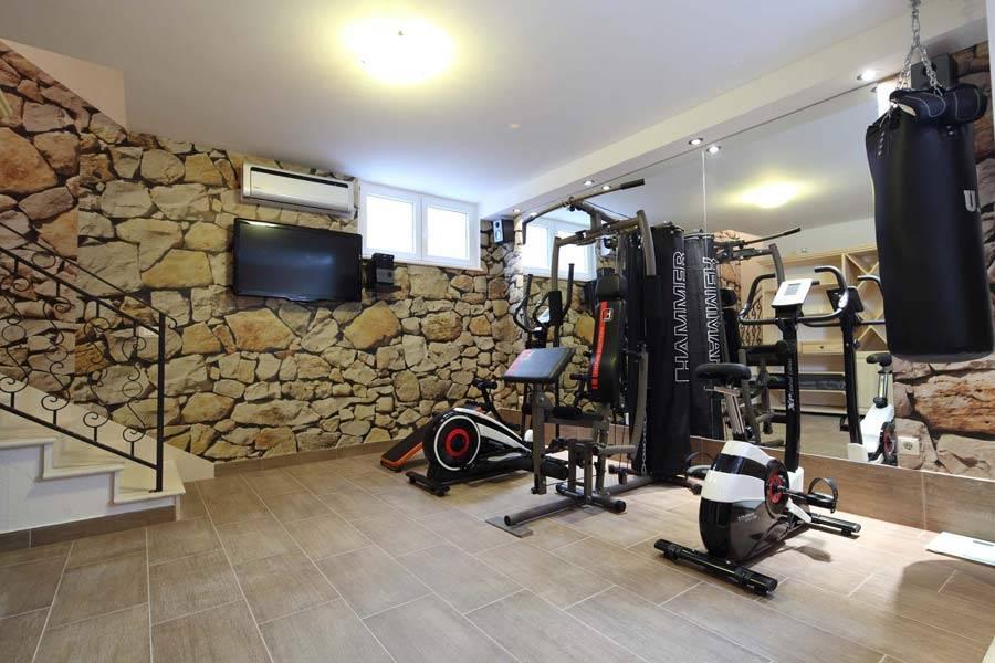 Как оборудовать тренажерный зал дома?