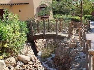 Мостик через сухой ручей: основные способы реализации, преимущества и варианты реализации