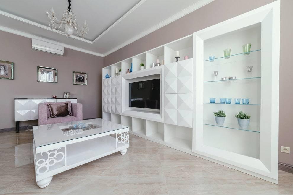 Шкаф в гостиную во всю стену - виды и правила выбора