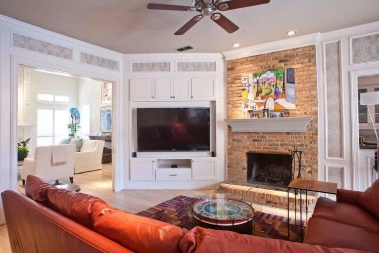 Электрокамин в интерьере гостиной (53 фото): электрические встроенные модели в комнате с телевизором, дизайн помещения площадью 18 квадратов в стиле лофт и минимализм
