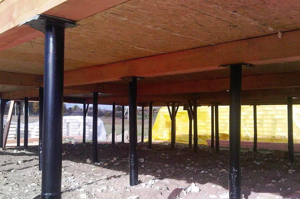 Свайный фундамент для каркасного дома: виды, преимущества, монтаж