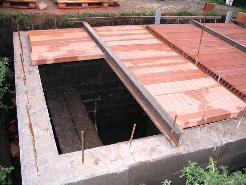 Пошаговая инструкция строительства погреба в гараже своими руками: как выкопать, отделка стен и фото