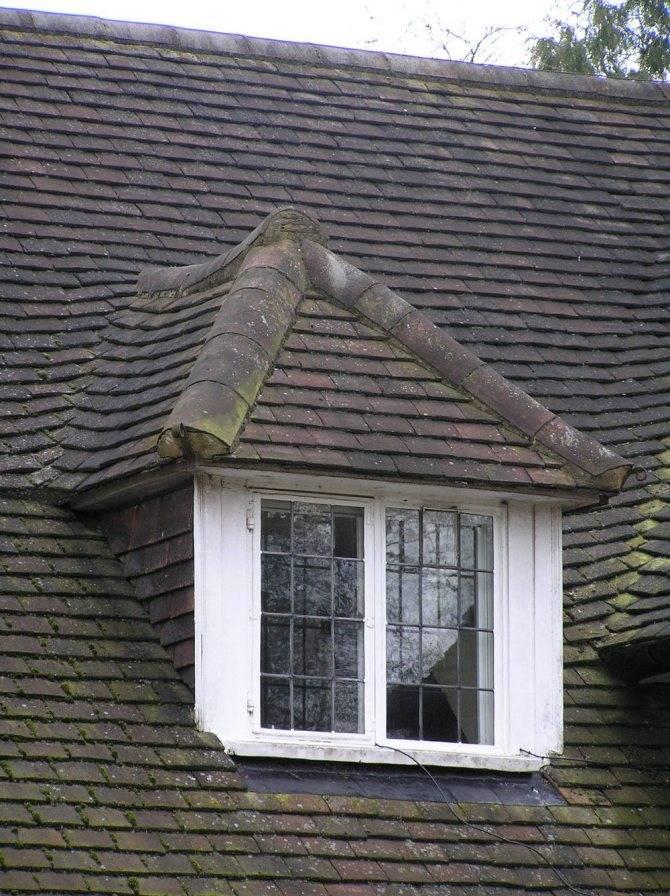 Слуховое окно на крыше: особенности конструкции
