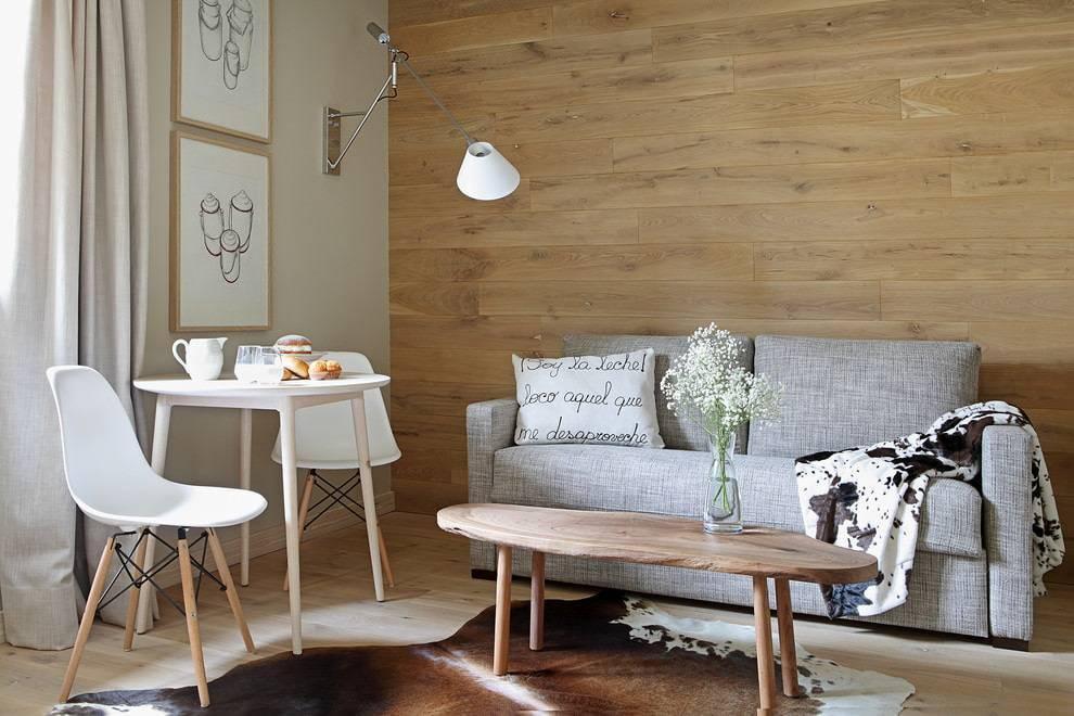 Ламинат на стене в интерьере: особенности применения и монтажа