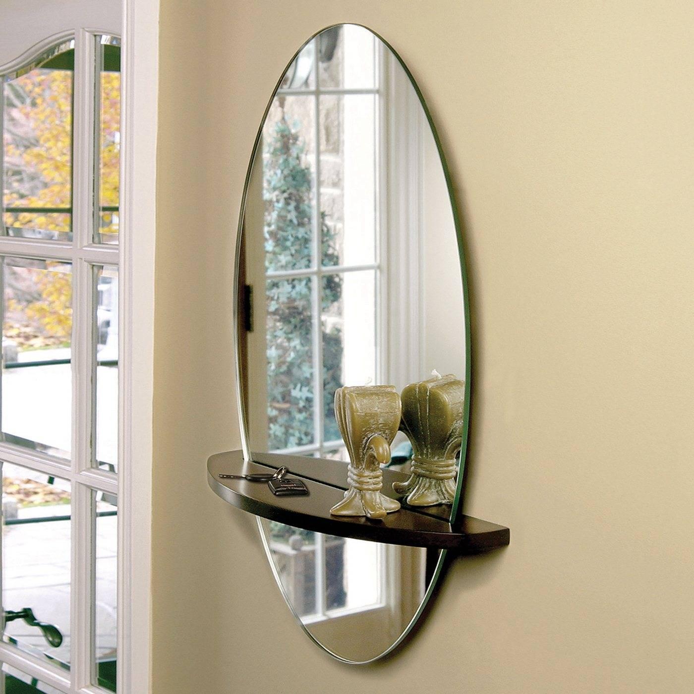 Овальное зеркало: модели с фацетом и тумбочкой, поворотное зеркало с большой рамой на ножках в спальню