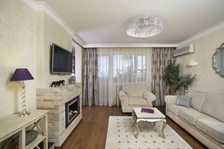 Имитация камина в интерьере квартиры, оригинальный дизайн гостиной