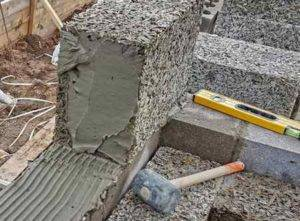 Дом из арболита: строительство из блоков(панелей) и монолита, технология, фундамент и опалубка, плюсы и минусы